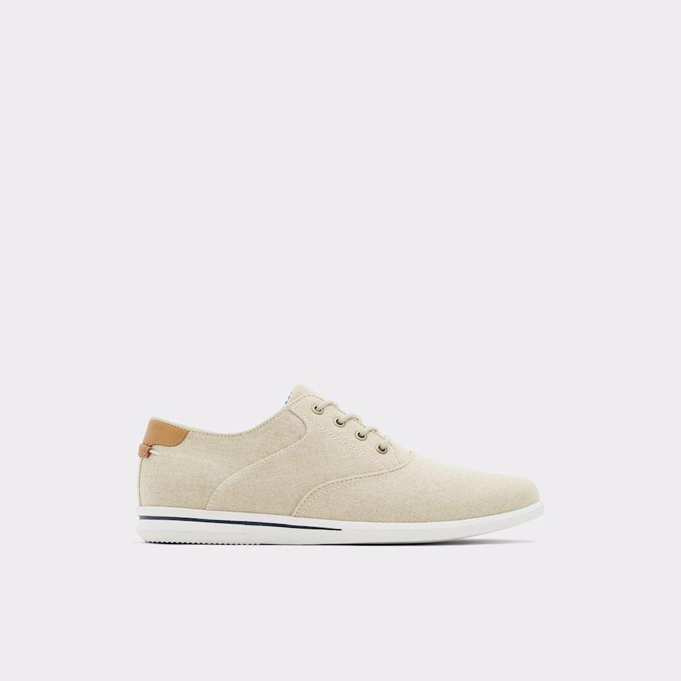 """<p><strong>ALDO</strong></p><p>aldoshoes.com</p><p><strong>$80.00</strong></p><p><a href=""""https://go.redirectingat.com?id=74968X1596630&url=https%3A%2F%2Fwww.aldoshoes.com%2Fus%2Fen_US%2Fp%2F12994754&sref=https%3A%2F%2Fwww.menshealth.com%2Fstyle%2Fg36283507%2Fmens-dress-sneakers%2F"""" rel=""""nofollow noopener"""" target=""""_blank"""" data-ylk=""""slk:BUY IT HERE"""" class=""""link rapid-noclick-resp"""">BUY IT HERE</a></p><p>Keep it casual this summer with these canvas-covered oxfords. Wear these with shorts, swimwear—any day you're taking it easy but still want to look sharp. </p>"""