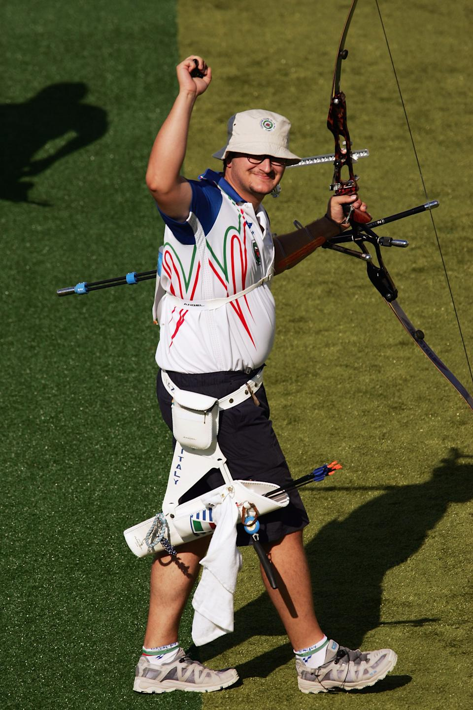 ATHENS - AUGUST 19: Marco Galiazzo of Italy celebrates his victory against Laurence Godfrey in the men's individual semifinal match on August 19, 2004 during the Athens 2004 Summer Olympic Games at Panathinaiko Stadium in Athens, Greece. (Photo by Nick Laham/Getty Images)