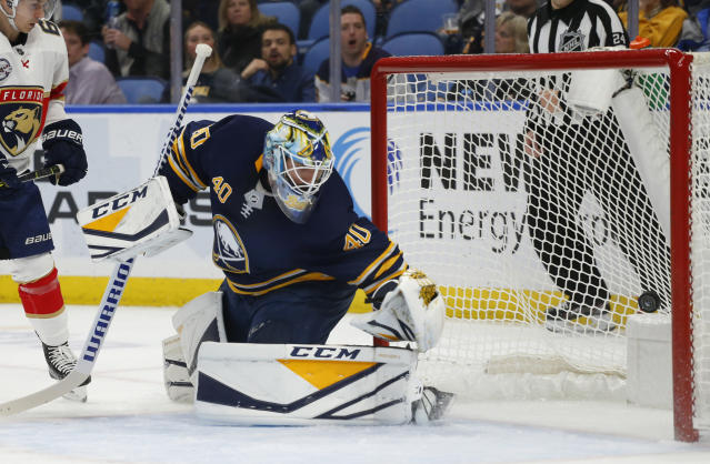Buffalo Sabres goalie Carter Hutton (40) watches the puck go into the net during the second period of an NHL hockey game against the Florida Panthers, Tuesday, Dec. 18, 2018, in Buffalo N.Y. (AP Photo/Jeffrey T. Barnes)