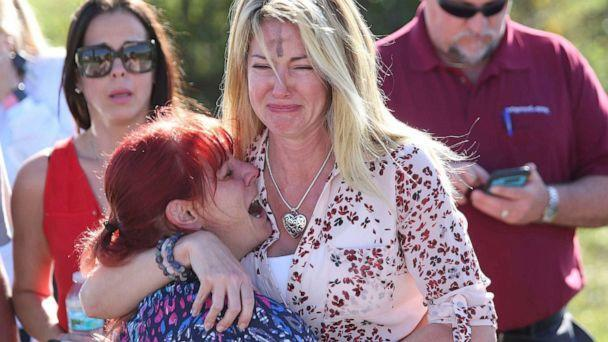PHOTO: Women embrace in a waiting area for parents of students after a shooting at Marjory Stoneman Douglas High School in Parkland, Fla., Feb. 14, 2018. (Joel Auerbach/AP, FILE)