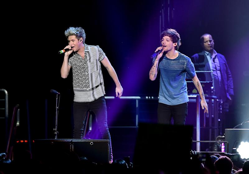 Niall Horan and Louis Tomlinson in concert