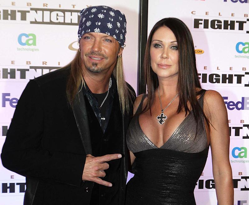 """FILE - This March 19, 2011 file photo shows singer Bret Michaels and his girlfriend Kristi Gibson at Muhammad Ali Celebrity Fight Night XVII in Phoenix. Michaels and his longtime girlfriend Kristi Gibson have called off their engagement. Michael's publicist, Joanna Mignano, said in a statement Monday, July 30, 2012, that the couple has separated.  Michaels and Gibson have dated on- and off-again for about 18 years. They have two daughters, Raine Elizabeth and Jorja Bleu. The statement reads that the parents will """"remain great friends and are committed to jointly raising"""" their daughters.  (AP Photo/Darryl Webb, file)"""