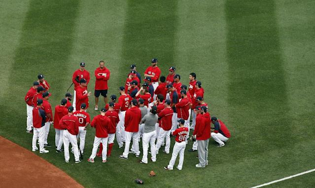 Boston Red Sox baseball players gather around manager John Farrell before a team workout at Fenway Park in Boston, Thursday, Oct. 10, 2013, as they prepare for Game 1 of the ALCS, Saturday. (AP Photo/Elise Amendola)