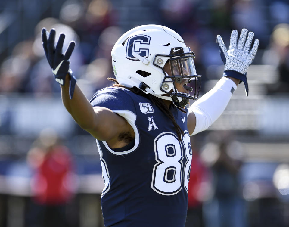 Connecticut wide receiver Matt Drayton (88) celebrates after scoring during the first half of an NCAA college football game against Houston, Saturday, Oct. 19, 2019, in East Hartford, Conn. (AP Photo/Stephen Dunn)
