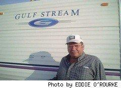 man in cap in front of gulfstream RV - new migrant workers