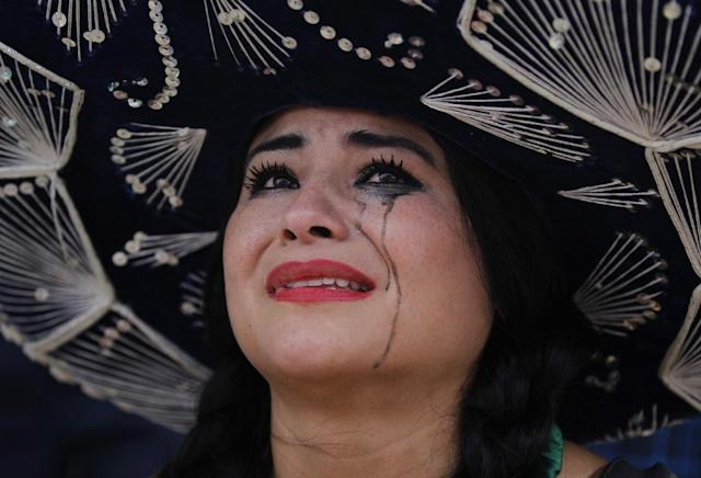 10ThingstoSeeSports - A Mexico soccer fan cries after her team was defeated in the World Cup round of 16 match against Netherlands on a live telecast inside the FIFA Fan Fest area on Copacabana beach in Rio de Janeiro, Brazil, Sunday, June 29, 2014. The Netherlands staged a dramatic late comeback, scoring two goals in the dying minutes to beat Mexico 2-1 and advance to the World Cup quarterfinals. (AP Photo/Leo Correa, File)