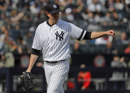 New York Yankees starting pitcher James Paxton motions to teammates after forcing Baltimore Orioles' Renato Nunez to ground out into a double play to end the top of the fourth inning of a baseball game, Saturday, March 30, 2019, in New York. (AP Photo/Julie Jacobson)