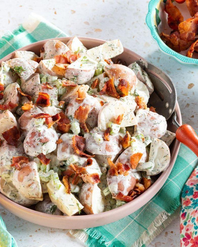 """<p>What's a patriotic party without potato salad? Here, bits of celery and bacon add a nice crunch to an otherwise creamy dish.</p><p><strong><a href=""""https://www.thepioneerwoman.com/food-cooking/recipes/a35888627/red-potato-salad/"""" rel=""""nofollow noopener"""" target=""""_blank"""" data-ylk=""""slk:Get the recipe"""" class=""""link rapid-noclick-resp"""">Get the recipe</a>.</strong></p><p><a class=""""link rapid-noclick-resp"""" href=""""https://go.redirectingat.com?id=74968X1596630&url=https%3A%2F%2Fwww.walmart.com%2Fbrowse%2Fhome%2Ftools-gadgets%2Fthe-pioneer-woman%2F4044_623679_133020%2FYnJhbmQ6VGhlIFBpb25lZXIgV29tYW4ie&sref=https%3A%2F%2Fwww.thepioneerwoman.com%2Ffood-cooking%2Fmeals-menus%2Fg32157273%2Ffourth-of-july-appetizers%2F"""" rel=""""nofollow noopener"""" target=""""_blank"""" data-ylk=""""slk:SHOP KITCHEN TOOLS""""><strong>SHOP KITCHEN TOOLS</strong></a></p>"""