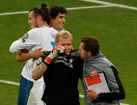 Soccer Football - Champions League Final - Real Madrid v Liverpool - NSC Olympic Stadium, Kiev, Ukraine - May 26, 2018 Liverpool's Loris Karius is dejected after losing the Champions League final as Real Madrid's Gareth Bale celebrates REUTERS/Phil Noble