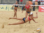 Sanne Keizer, bottom, and Marleen Van Iersel of the Netherlands compete during the women's match against the team of Karla Borger and Britta Buthe of Germany in the Beach Volleyball World Tour Grand Slam at Jinshan, outskirts of Shanghai, China, Thursday, May 3, 2012. (AP Photo/Eugene Hoshiko)