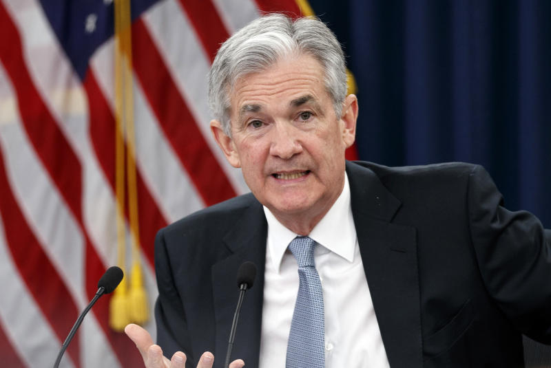 Fed raises key rate and foresees 2 more hikes this year