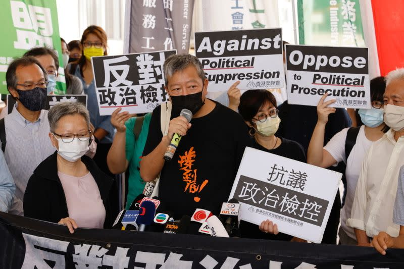 Pro-democracy activist Lee Cheuk-yan speaks to media as he arriving at the West Kowloon Courts for verdicts in landmark unlawful assembly case, in Hong Kong