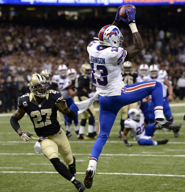 Buffalo Bills wide receiver Steve Johnson (13) pulls in a touchdown reception in front of New Orleans Saints free safety Malcolm Jenkins (27) during the first half of an NFL football game in New Orleans, Sunday, Oct. 27, 2013. (AP Photo/Bill Feig)