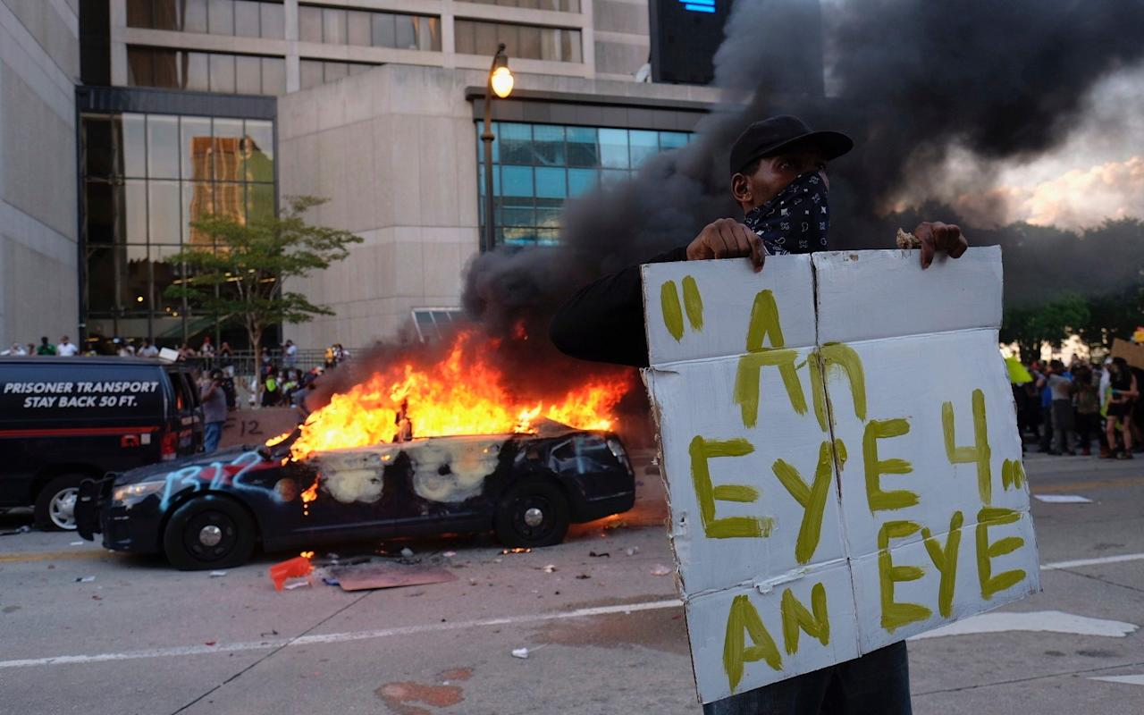 Protests took place for a third night in Minneapolis - AP