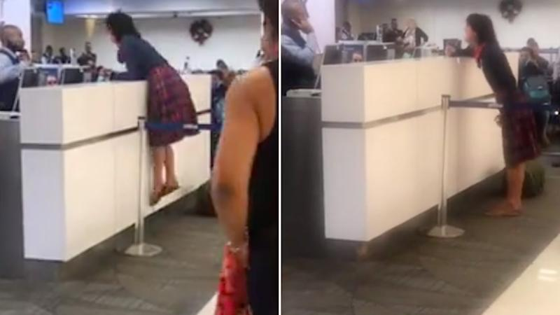 Screaming woman lunges at airport staff while calling them rapists