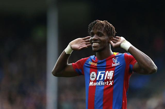 Wilfried Zaha has never played for the Ivory Coast, which he left with his family when he was just four (AFP Photo/Ian KINGTON)