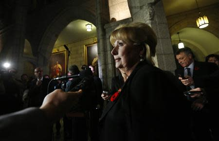 Pamela Wallin delivers a statement to journalists following a vote in the Senate on Parliament Hill in Ottawa