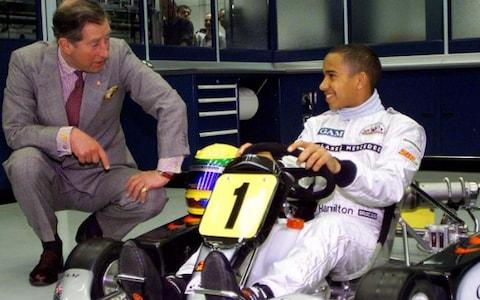 Prince Charles talks to a 14-year-old Lewis Hamilton at the McLaren factory - Credit: Reuters