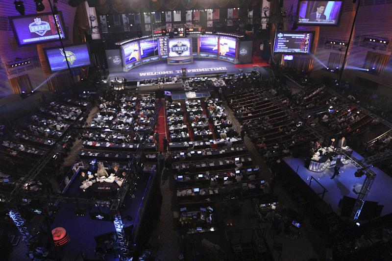 Fans look on during the fourth round of the NFL football draft at Radio City Music Hall, Saturday, April 28, 2012 in New York. (AP Photo/Mary Altaffer)