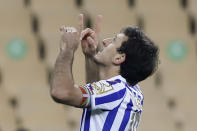 Real Sociedad's Mikel Oyarzabal celebrates scoring his side's first goal with a penalty shot during the final of the 2020 Copa del Rey, or King's Cup, soccer match between Athletic Bilbao and Real Sociedad at Estadio de La Cartuja in Sevilla, Spain, Saturday April 3, 2021. The game is the rescheduled final of the 2019-2020 competition which was originally postponed due to the coronavirus pandemic. (AP Photo/Angel Fernandez)