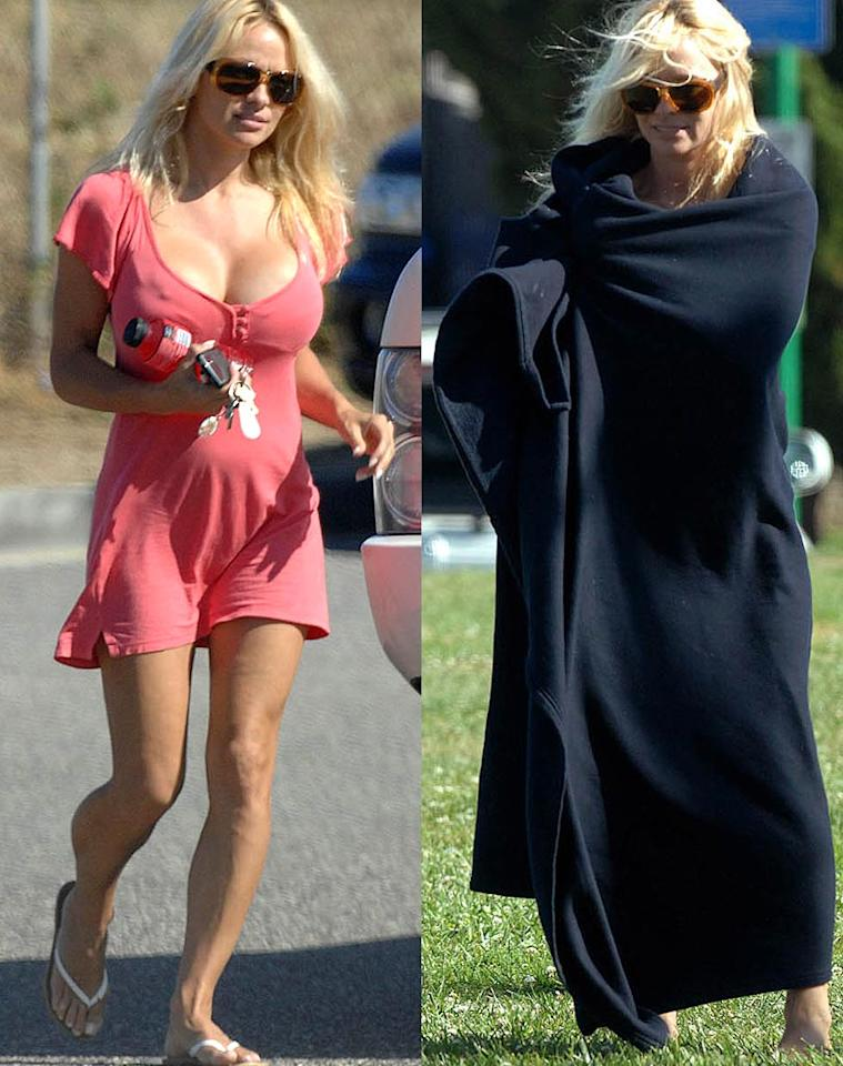 "After realizing that her bodacious figure was barely covered at her son's baseball game, Pam Anderson avoided a ticket for indecent exposure by hiding under a blanket. Whittle/<a href=""http://www.splashnewsonline.com"" target=""new"">Splash News</a> - April 14, 2008"