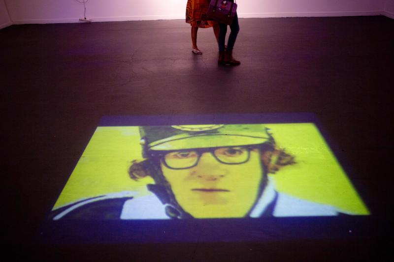 """An image of Woody Allen is projected on the floor at an art exhibit titled """"Queremos tanto a Woody,"""" or """"We so love Woody"""" by Argentine artist Hugo Echarri in Buenos Aires, Argentina, Thursday, Feb. 6, 2014. The exhibit in honor of Allen was inaugurated just days after the artist faced renewed accusations that he molested Dylan Farrow, his then-7-year-old adopted daughter in 1992. (AP Photo/Rodrigo Abd)"""