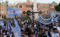Activists against abortion gather at Plaza de Mayo to protest against the decriminalization of abortion, one day before lawmakers will debate its legalization, in Buenos Aires, Argentina, Monday, Dec. 28, 2020. (AP Photo/Victor R. Caivano)