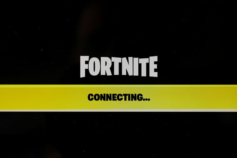 "The popular video game ""Fortnite"" by Epic Games is pictured on a screen"