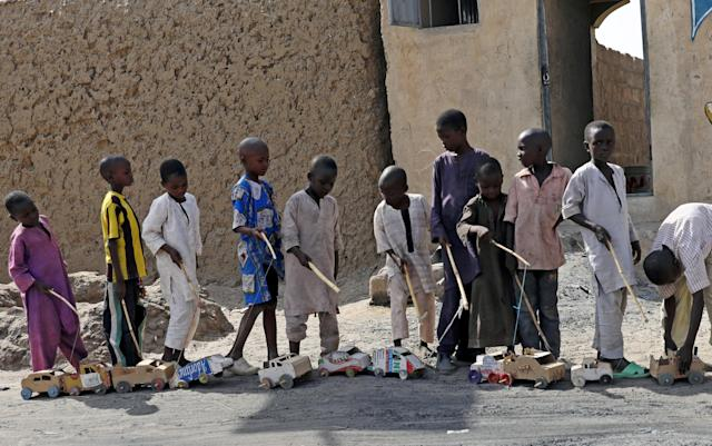Boys play outside a bakery in Dapchi, in the northeastern state of Yobe, Nigeria March 22, 2018. REUTERS/Afolabi Sotunde TPX IMAGES OF THE DAY