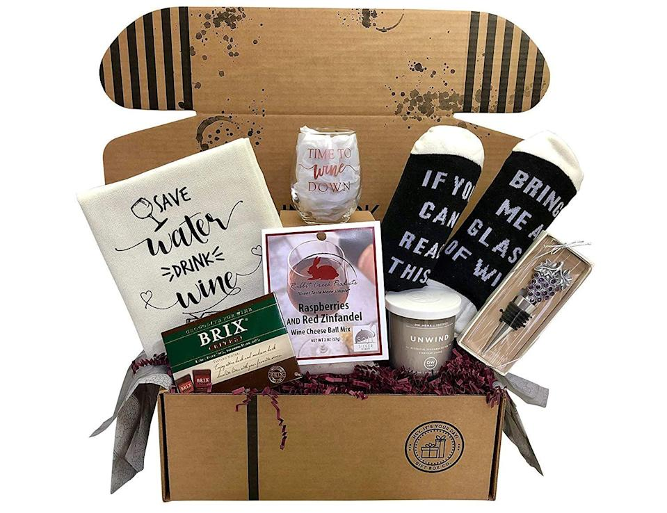 """<p><strong>HEY, IT'S YOUR DAY! GIFT BOX CO.</strong></p><p>amazon.com</p><p><strong>$54.95</strong></p><p><a href=""""https://www.amazon.com/dp/B076BBTLC9?tag=syn-yahoo-20&ascsubtag=%5Bartid%7C10070.g.35756207%5Bsrc%7Cyahoo-us"""" rel=""""nofollow noopener"""" target=""""_blank"""" data-ylk=""""slk:SHOP NOW"""" class=""""link rapid-noclick-resp"""">SHOP NOW</a></p><p>Wine lovers will rejoice for this thoughtful basket, which includes cozy socks, a custom stemless wine glass, a bottle stopper, a raspberry and red zinfandel cheese ball mix, napkins, and wine chocolates. All you need to complete it is a bottle of your mom's fave vino. </p>"""
