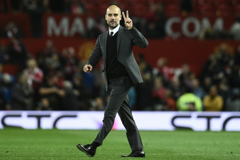 Manchester City's manager Pep Guardiola on the pitch after the English Football League Cup fourth round match between Manchester United and Manchester City at Old Trafford in Manchester, north west England on October 26, 2016