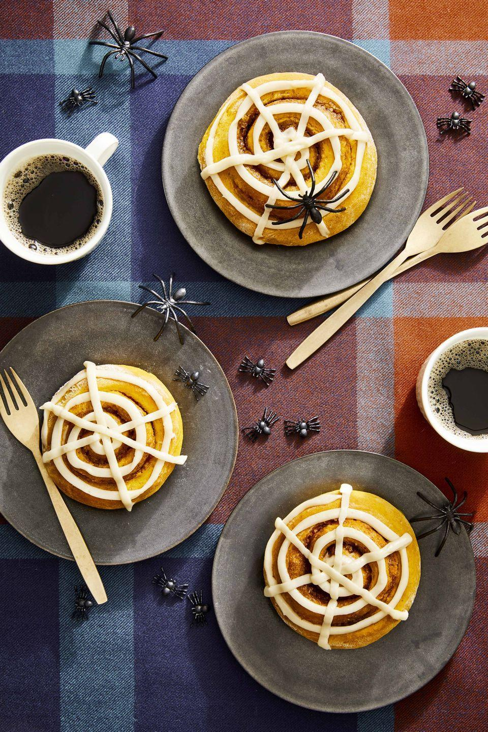 """<p>These sweet, spooky-looking buns are packed with seasonal flavors, and go perfectly with a cup of coffee after dinner.</p><p><strong><a href=""""https://www.countryliving.com/food-drinks/a33943653/pumpkin-spiced-buns/"""" rel=""""nofollow noopener"""" target=""""_blank"""" data-ylk=""""slk:Get the recipe"""" class=""""link rapid-noclick-resp"""">Get the recipe</a>.</strong></p><p><strong><a class=""""link rapid-noclick-resp"""" href=""""https://www.amazon.com/6-5-QT-6-Speed-Tilt-Head-Kitchen-Electric/dp/B07NY886CD/?tag=syn-yahoo-20&ascsubtag=%5Bartid%7C10050.g.454%5Bsrc%7Cyahoo-us"""" rel=""""nofollow noopener"""" target=""""_blank"""" data-ylk=""""slk:SHOP ELECTRIC MIXERS"""">SHOP ELECTRIC MIXERS</a></strong></p>"""