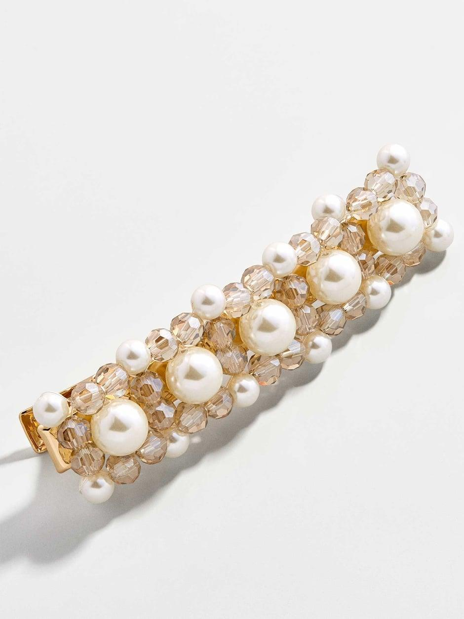 "<p><a href=""https://www.popsugar.com/buy/Dix-Pearl-Hair-Clip-570418?p_name=Dix%20Pearl%20Hair%20Clip&retailer=baublebar.com&pid=570418&price=10&evar1=fab%3Aus&evar9=47437458&evar98=https%3A%2F%2Fwww.popsugar.com%2Fphoto-gallery%2F47437458%2Fimage%2F47440736%2FDix-Pearl-Hair-Clip&list1=shopping%2Cjewelry%2Caccessories%2Cbaublebar%2Cspring%20fashion%2Csale%20shopping%2Cfashion%20shopping&prop13=api&pdata=1"" class=""link rapid-noclick-resp"" rel=""nofollow noopener"" target=""_blank"" data-ylk=""slk:Dix Pearl Hair Clip"">Dix Pearl Hair Clip</a> ($10, originally $22)</p>"