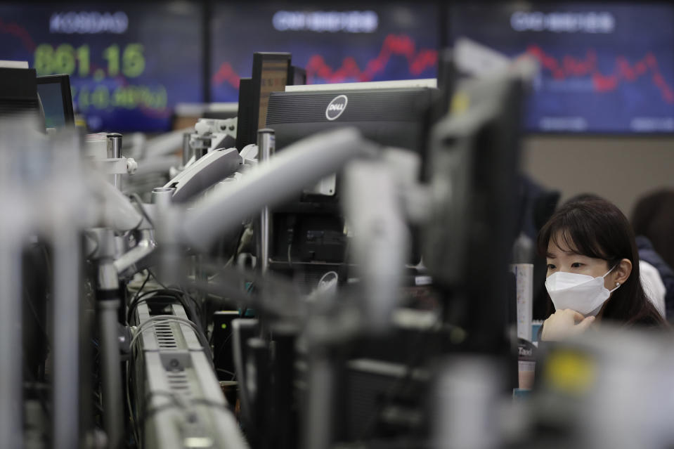 A currency trader watches computer monitors at the foreign exchange dealing room in Seoul, South Korea, Thursday, Nov. 26, 2020. Asian shares were mixed Thursday, after Wall Street took a pause from the optimism underlined in a record-setting climb earlier in the week. (AP Photo/Lee Jin-man)