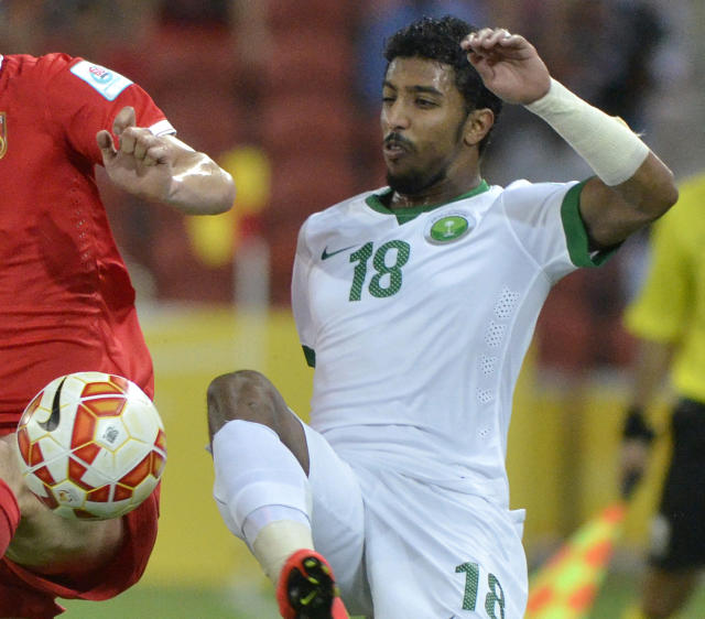 FILE - In this Jan. 10, 2015, file photo, Saudi Arabia's Salem Al-Dawsari battles for the ball during a first round soccer match against China at the AFC Asia Cup in Brisbane, Australia. After years of Saudi Arabian players staying home, nine were sent to clubs in the top two tiers of Spanish football in January until the end of the current season. Three of those, Al-Dawsari, Fahad Al Muwallad and Yahya Shehri, are established internationals and have been named in the latest roster to take on Ukraine and Belgium in World Cup warm-ups on Friday, March 23, 2018 and next Tuesday, March 27. (AP Photo/Steve Holland, File)