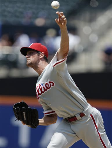 Philadelphia Phillies' Cole Hamels delivers a pitch during the first inning of a baseball game against the New York Mets Saturday, July 20, 2013, in New York. (AP Photo/Frank Franklin II)