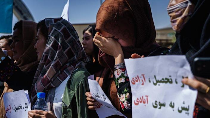One woman weeps during a protest against the news of an all-male interim government in Afghanistan