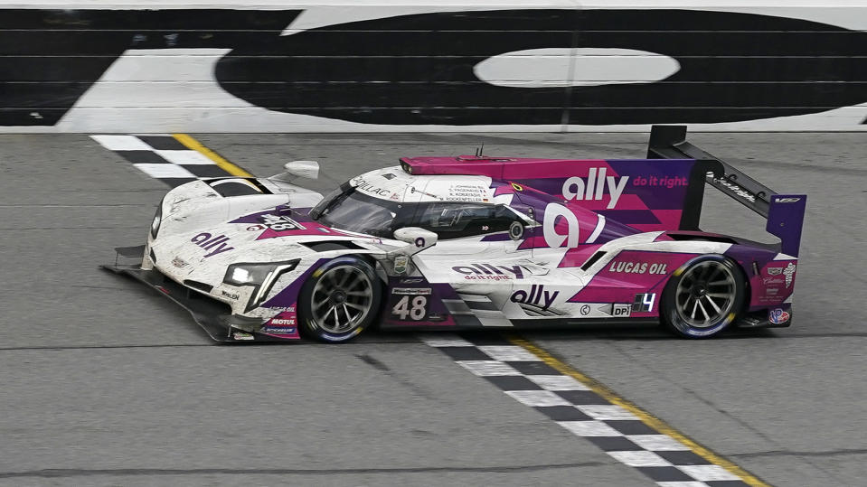 Kamu Kobayashi, of Japan, drives the Ally Racing Cadillac DPi during the final laps of the Rolex 24 hour auto race at Daytona International Speedway, Sunday, Jan. 31, 2021, in Daytona Beach, Fla. (AP Photo/John Raoux)