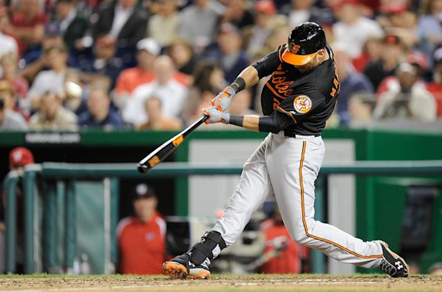 WASHINGTON, DC - MAY 18: Nick Markakis #21 of the Baltimore Orioles hits a home run in the eleventh inning against the Washington Nationals at Nationals Park on May 18, 2012 in Washington, DC. Baltimore won the game 2-1. (Photo by Greg Fiume/Getty Images)