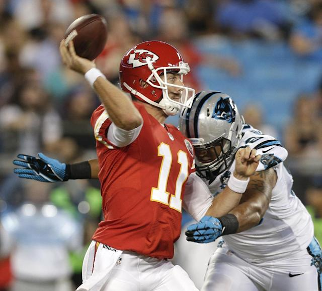 Kansas City Chiefs' Alex Smith (11) looks to pass under pressure from Carolina Panthers' Star Lotulelei (98) during the first half of a preseason NFL football game in Charlotte, N.C., Sunday, Aug. 17, 2014. (AP Photo/Chuck Burton)