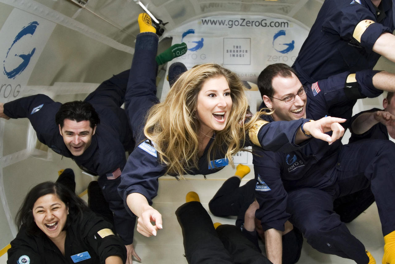 This undated image provided by Sonja Rohde, center, shows her weightlessness training session on a Zero G flight that took off from Cape Canaveral, Fla. Rohde, who is from Hagen, Germany, is among the first 100 people to have booked flights with the Virgin Galactic spaceline. (AP Photo/Courtesy of Sonja Rohde/Zero G)