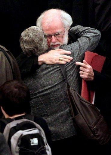 """<p>Archbishop of Canterbury Rowan Williams hugs a female member of the clergy at Church House in central London on November 20. The Church of England has """"undoubtedly"""" lost credibility after voting to reject the appointment of women bishops, its leader the Archbishop of Canterbury said Wednesday.</p>"""
