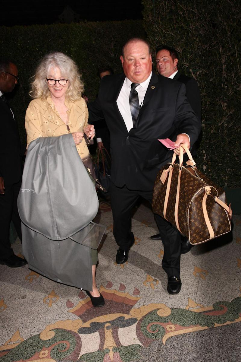 Gwyneth's Mum, Blythe Danner, left the venue holding a Monique Lhuillier Bridal garment bag, fuelling rumours that her daughter secretly wed.