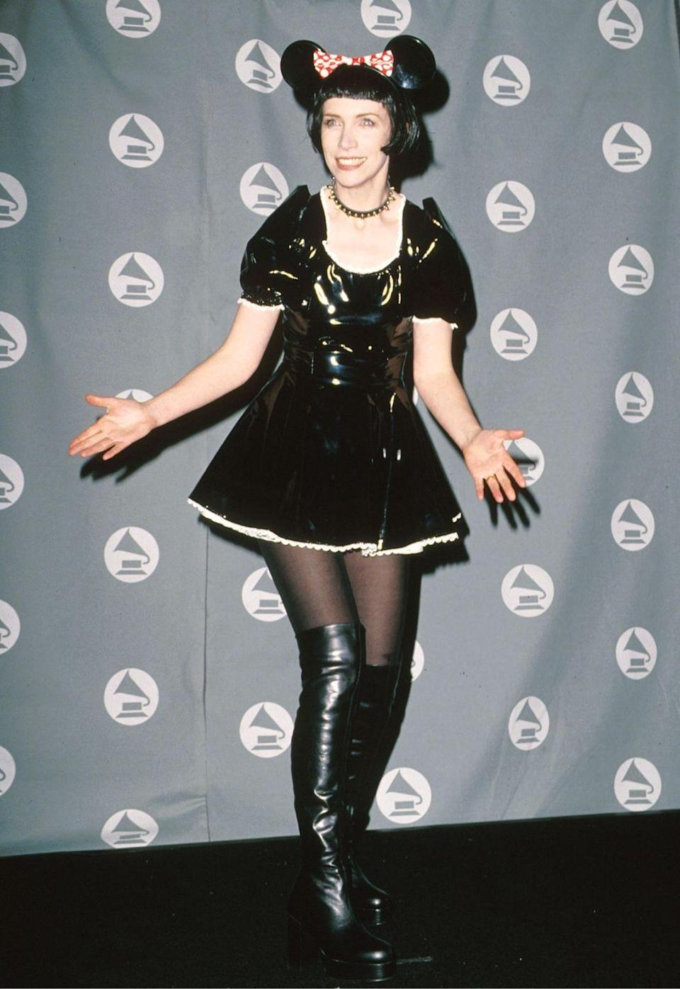 <p>The Scottish singer wore a Minnie Mouse–inspired outfit with a black-and-white latex dress, over-the-knee boots, and mouse ears to the Grammy Awards. </p>