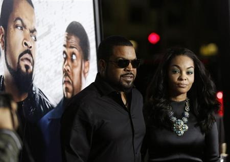 "Cube and his wife Kimberly Woodruff pose at the premiere of ""Ride Along"" at the TCL Chinese theatre in Hollywood"