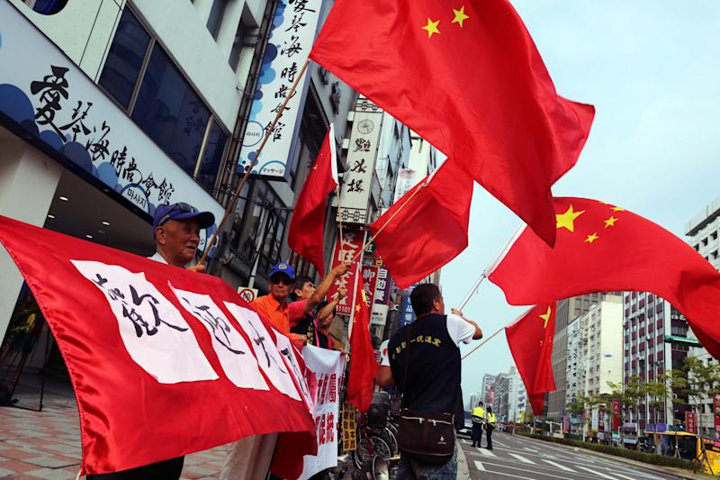 Pro-China supporters wave the Chinese flag before the opening of the 29th Summer Universiade, in Taipei, Taiwan