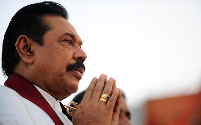 Sri Lankan President Mahinda Rajapakse's party still holds a comfortable simple majority, but loss of the two-thirds support means it can carry out no constitutional changes without opposition support (AFP Photo/Ishara S.Kodikara)