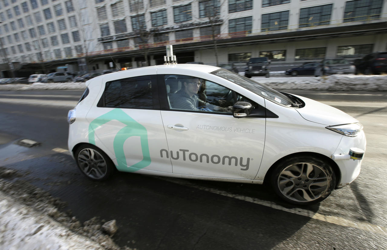 FILE - In this Tuesday, Jan. 10, 2017, file photo, an autonomous vehicle is driven by an engineer on a street in an industrial park in Boston. A new study inspired by Boston's early experiments with self-driving cars finds that the technology could ease congestion, but also lead to more cars on the road and further encourage urban sprawl. (AP Photo/Steven Senne, File)