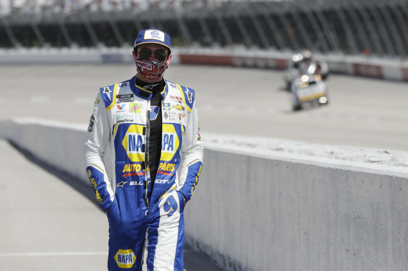 Driver Chase Elliott walks to his car for the start of the NASCAR Cup Series auto race Sunday, May 17, 2020, in Darlington, S.C. (AP Photo/Brynn Anderson)