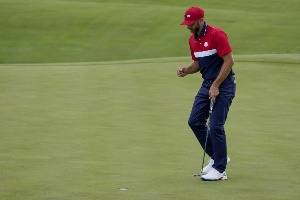 Team USA's Dustin Johnson reacts to his putt on the 17th hole during a Ryder Cup singles match at the Whistling Straits Golf Course Sunday, Sept. 26, 2021, in Sheboygan, Wis. (AP Photo/Ashley Landis)